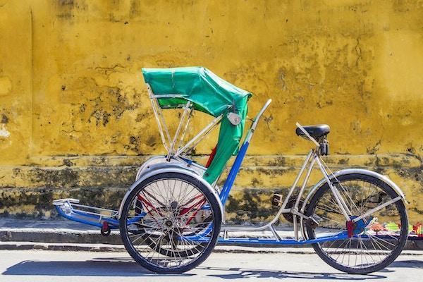 Trehjuling brukes til å frakte turister rundt den UNESCO-noterte antikke byen Hoi An, sentrale Vietnam.