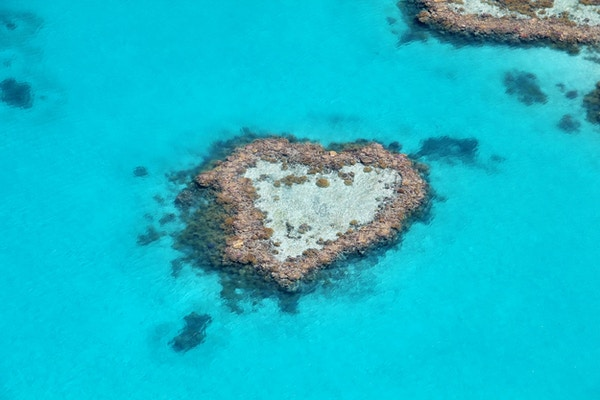 Fotografi av Heart Reef på en naturskjønn flytur over Great Barrier Reef