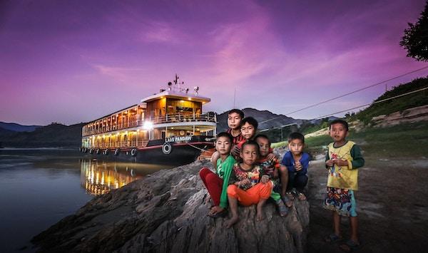 Herlige møter med de lokale når du seilier på Mekong gjennom Laos