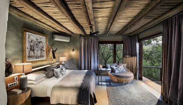 Guest cottage bedroom at andbeyond phinda rock lodge 1